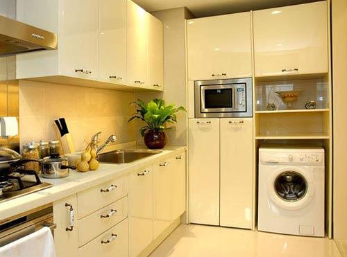 Máy giặt được bố trí trong tủ bếp