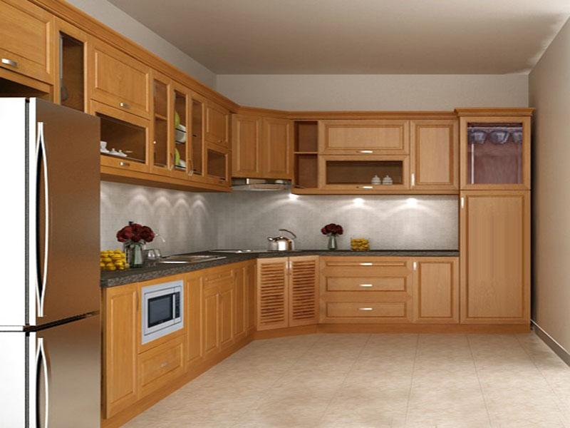 Màu vàng nhạt đặc trưng của tủ bếp gỗ xoan
